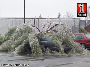 iReporter Candy Novoa says she woke up Friday to find a tree branch lying across her neighbor's car.