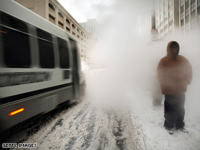 A worker shovels snow as the storm hits Chicago, Illinois, early Friday.
