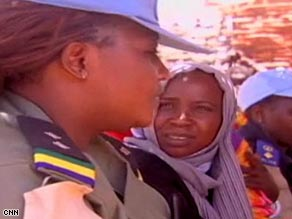 UNAMID police officer Ajayi Funmi, left, educates Darfur women about rape.