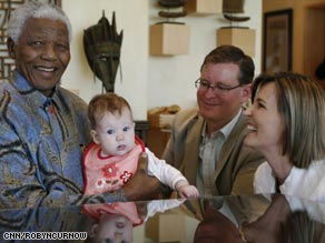 Baby Freya cries as Mandela tries to placate her.