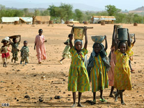 Refugee girls pose for a picture at a camp in Darfur.