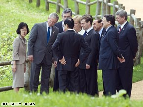 The G-8 leaders, with Hokkaido Governor Takahashi (left), at a tree-planting ceremony Tuesday.