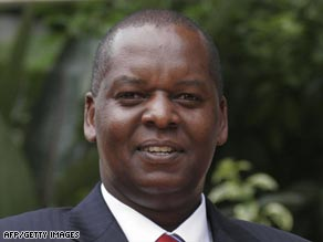 Kenya's finance minister Amos Kimunya has resigned after being named in a corruption scandal.