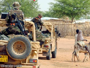 Peacekeepers drive into a Sudanese refugee camp near Farchana, east of Chad.