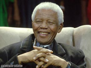 Mandela sits at the 6th Nelson Mandela Lecture in Soweto, Johannesburg.