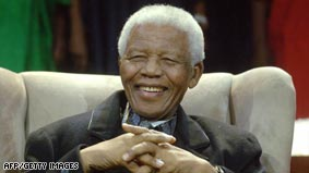 Nelson Mandela celebrates 90th, attacks poverty 