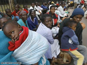 About 200 victims of election violence seek safety outside the U.S. Embassy in Harare, Zimbabwe, this month.