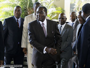 Zimbabwean President Robert Mugabe, right, meets South African President Thabo Mbeki, left, in Harare.