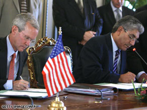 U.S. Assistant Secretary of State David Welch, left, and Libyan Deputy Foreign Minister Ahmad Fitouri sign the deal.