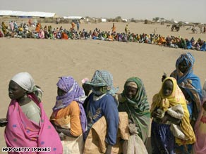 A file photo of refugees queuing for food in the Kalma camp in western Sudan.