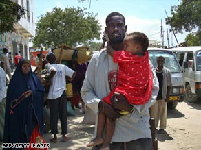 A Mogadishu resident flees after fighting among insurgents and  peacekeepers on September 24.