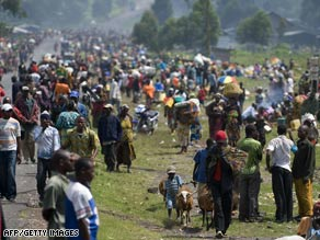 Thousands of displaced Congolese on Tuesday line the road near the Kibati camp north of Goma, Congo.