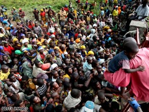 A crowd of refugees gathers at the entrance to a USAID center near Goma in the Democratic Republic of Congo.