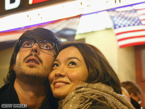 A German-speaking couple in Berlin watches the U.S. elections on TV late Tuesday night.