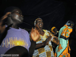 Residents of Kogelo, Kenya, celebrate news of Barack Obama's victory early Wednesday morning.