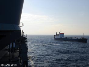 A U.S. Navy patrol monitors the MV Faina -- in the hands of pirates since September 25.