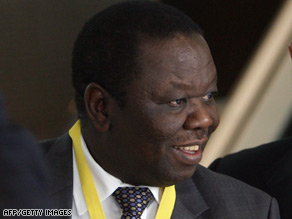 MDC leader Morgan Tsvangirai accuses Robert Mugabe's ZANU-PF party of grabbing key ministries.