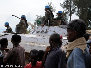 U.N. troops enter a peacekeeper base in Kanyabayonga on Tuesday.