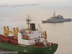 A French frigate shadows a commercial ship leaving Djibouti harbor on its way to the Gulf of Aden.