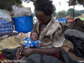 Congolese Anosiate Nyirahabineza holds her son Jeremiah in Kampala, Uganda, in June.