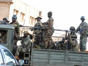 Soldiers patrol the streets in Jos after the riots.