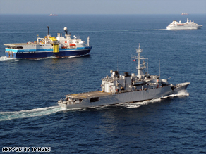 The French frigate Nivose escorts commercial ships in the Gulf of Aden on November 28.
