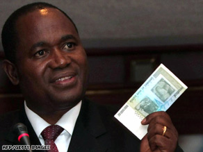 Zimbabwe central bank governor Gideon Gono shows a new $50 million note at a news conference Thursday.