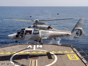 A French army helicopter taking off from French frigate Nivose,  on patrol in the Gulf of Aden.