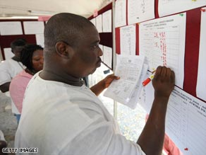 An election official adds to the election results displayed at the Ghanaian International Press Centre.