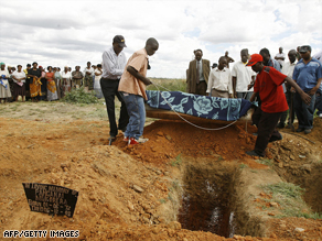 A Zimbabwean family bury their relative, who died of cholera, 25km from Harare, Zimbabwe.
