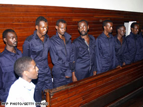 Some of the suspects facing trial are shown last month being arraigned in a Mombasa, Kenya, courtroom.