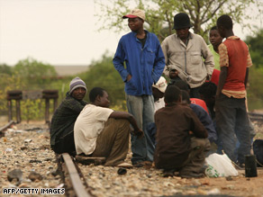 Cholera sufferers gather on the South African border after crossing over from Zimbabwe.