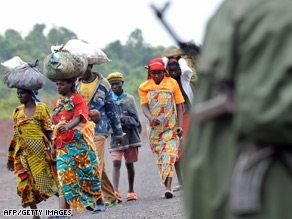 Congolese walk on a road near the front line near Kibati.