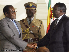 President Robert Mugabe, left, and opposition leader Morgan Tsvangirai signed the deal in July.