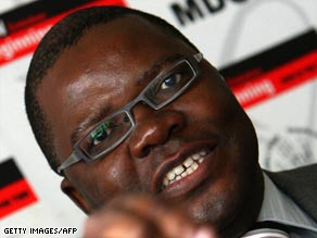 Opposition spokesman Tendai Biti answers reporters' questions on Monday in Harare.
