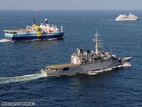 A French warship keeps guard over commercial vessels in the Gulf of Aden last month.