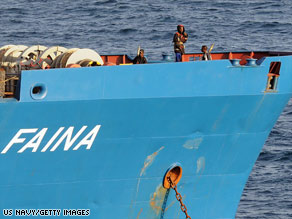 Somali pirates holding the MV Faina stand guard on the merchant vessel's deck on October 19.