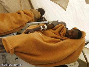 Cholera victims lie in a hospital ward in Harare, Zimbabwe, last week.