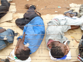 Children sleep in rough conditions on the border between Zimbabwe and South Africa.