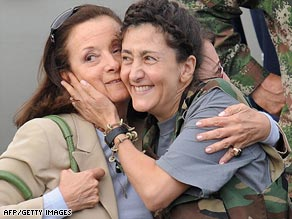 Ingrid Betancourt, right, with her mother as she walked off a military plane following her rescue Wednesday.