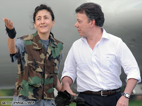 Former hostage Ingrid Betancourt with Colombian Defense Minister Juan Manuel Santos after her release.