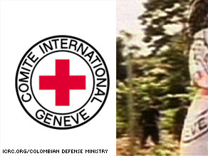 What seems to be part of a red cross is seen on a man involved in the rescue in this official image.