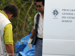 Forensic personnel analyze bodies found in a suburb of Merida, capital of Yucatan state.