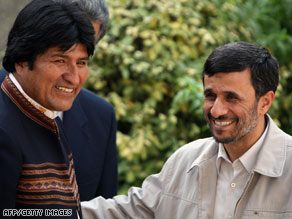 Iranian President Mahmoud Ahmadinejad, right, greets Bolivia's leader, Evo Morales, on Monday in Tehran.