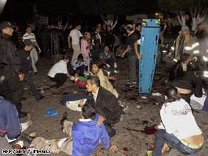 Wounded people get help after blasts Monday night during an independence day event in Morelia, Mexico.