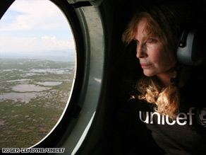 Mia Farrow views flooding in Haiti on a trip to the country devastated by a string of recent storms.