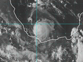 Tropical Storm Marco is just off the coast of Mexico, with sustained winds of 65 mph.