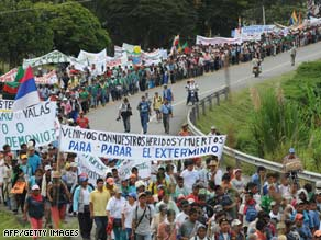 Demonstrators march along the Pan American Highway on Tuesday in Piendamo, Colombia.