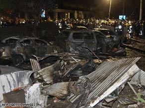 Firefighters at the scene of the crash Tuesday night in Mexico City.