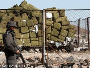 Mexico is the top marijuana producer, a U.N. report says. Here, a member of Mexico's army guards a drug seizure.